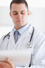 Close up of doctor checking notes