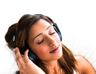 indian teenage girl, with headphones, eyes closed