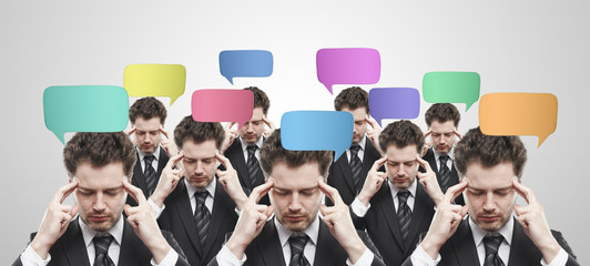 Group of businessmen with speech bubbles