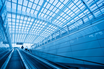 the escalator leading to the modern airport