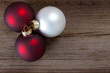 christmas baubles on weathered wood
