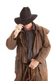 cowboy with duster holding hat poster