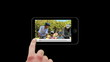 Smartphone showing families relaxing outside