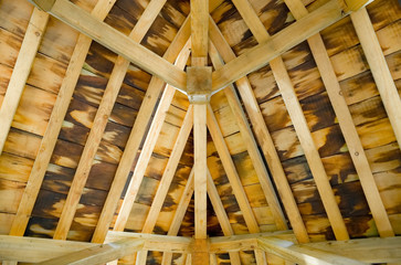sunlight creeping into a timber roof interior
