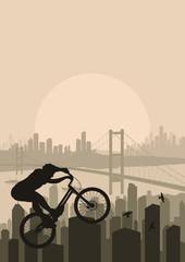 Mountain bike trial rider in skyscraper city landscape