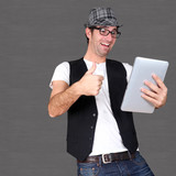 Funny guy using electronic tablet