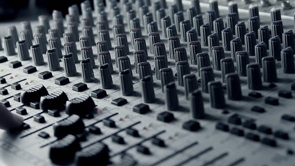 soundman DJ working on the mixing console sound