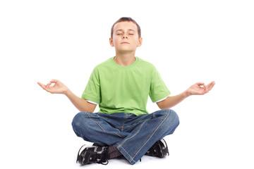 10 years old boy meditating