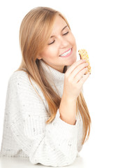 girl eating granola bar, white background