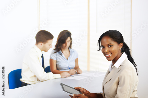 black businesswoman with a Tablet PC