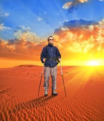 traveler in a desert at the sunset