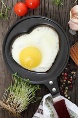 Breakfast with fried egg in heart-shaped form