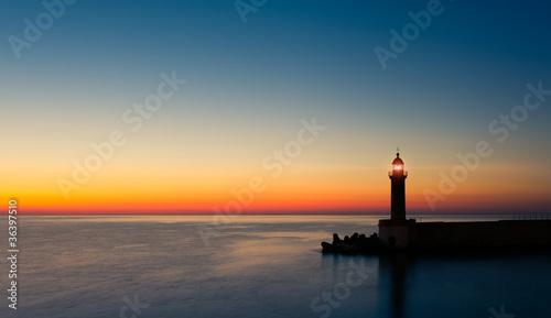 Leinwanddruck Bild phare crépuscule
