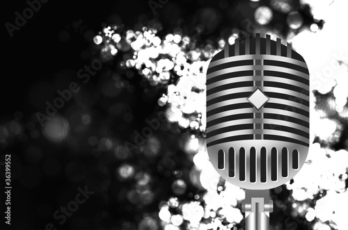 vintage microphone on stage with bokeh