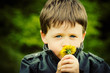 Child Smelling Flower