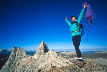 Female climber on the summit.