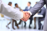 Fototapety Two successful businessman shaking hands in front