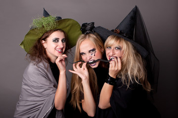 three witches eat  black snake