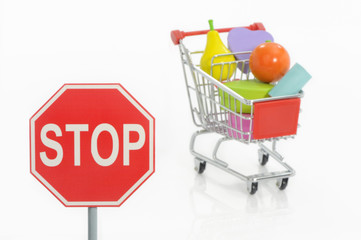 Stop traffic sign and shopping cart