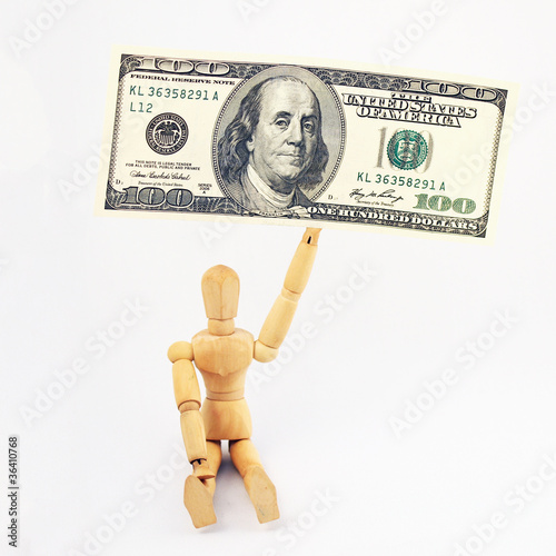 Seated man with a big 100 dollar bill in his hand