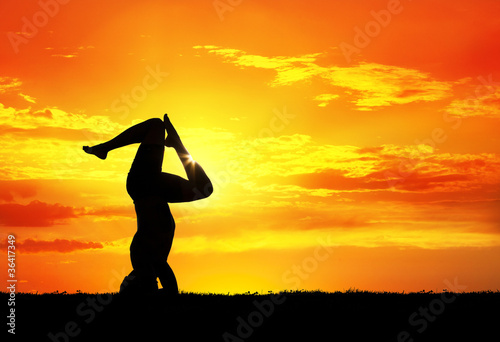 Yoga silhouette shirshasana pose