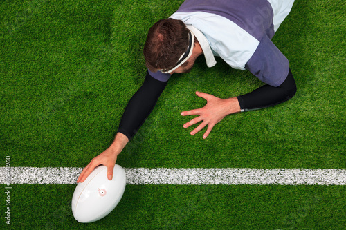 Poster Rugby player scoring a try with one hand on the ball