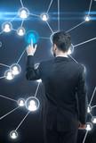 Businessman pressing a touchscreen Social Network button