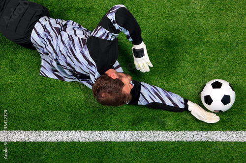 Overhead shot of a goalkeeper diving to save the ball