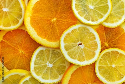 Fotobehang Plakjes fruit Zitronen- und Orangenscheiben
