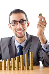 Growth concept with coins and businessman