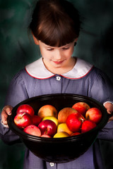 Child and Apples