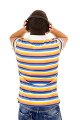 Back view of a young man listening music with headphones, isolat