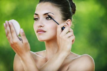 naked woman looks mirror dye eyelashes