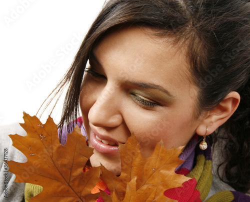Beautiful woman with a leaf