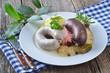 Leinwandbild Motiv Blut- und Leberwurst mit Wammerl auf Sauerkraut