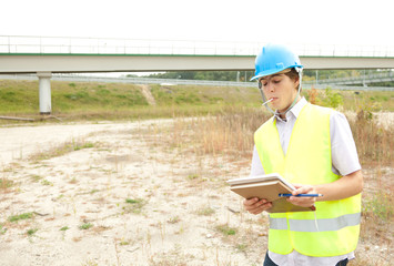 male architect checking work progress in construction site