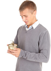young man unlocks canned food, white background