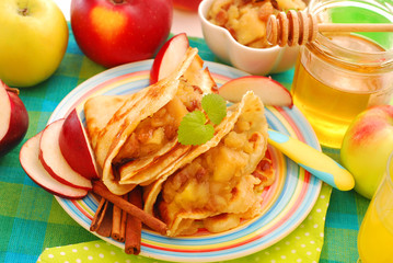 pancakes with stewed apples ,raisins and honey