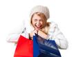 jubelnde Frau mit Einkaufstaschen