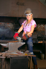 Attractive girl in workshop with instrument in hand