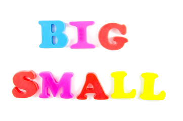 big and small written in fridge magnets