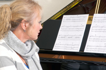 Pretty Blonde Woman At The Piano