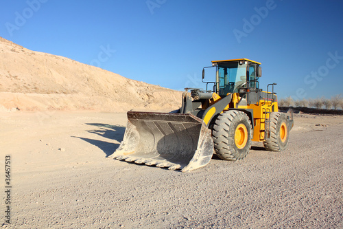 Front view of loader machine at the construction zone - 36457513