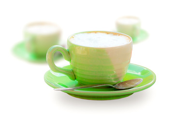 Cup of green coffee on white background