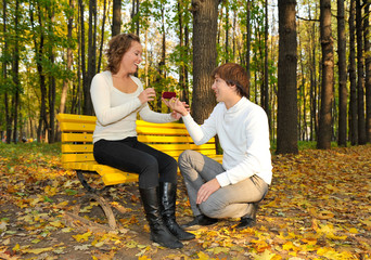 Boyfriend proposing marriage to girlfriend on the park
