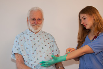 elderly man with medical professional