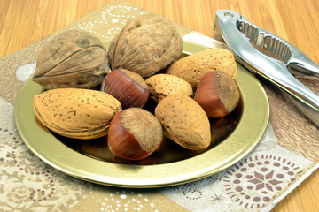 Selection of mixed nuts on a festive plate and napkin