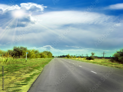 route and clouds on the sky as travel background