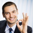 Business man with okay hand sign at office