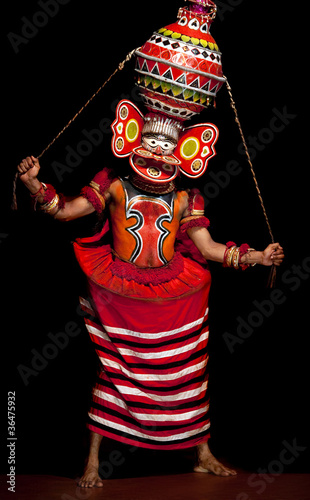 kathakali performer in a mask